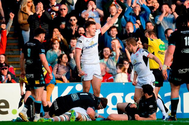 Ulster's Jacob Stockdale celebrates as Nick Timoney dives over for his sides third try. Photo: Oliver McVeigh/Sportsfile