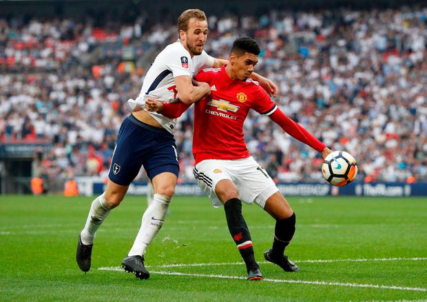 Manchester United's Chris Smalling in action with Tottenham's Harry Kane. Action Images via Reuters/John Sibley