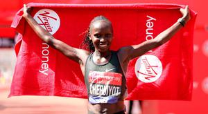 Kenya's Vivian Cheruiyot celebrates winning the Women's London Marathon