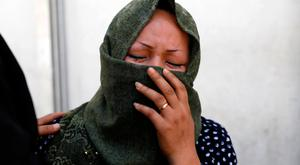 A woman mourns at a hospital after a suicide attack in Kabul, Afghanistan April 22, 2018.REUTERS/Mohammad Ismail
