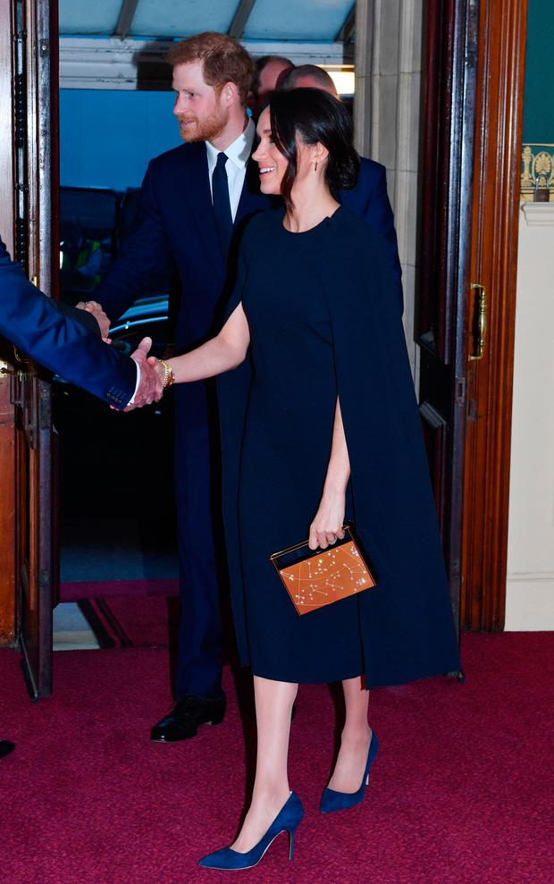 Prince Harry and Meghan Markle arrive at the Royal Albert Hall in London to attend a star-studded concert to celebrate the Queen's 92nd birthday. Photo: John Stillwell/PA Wire