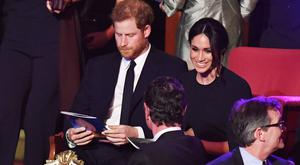 Britain's Prince Harry and Meghan Markle attend a special concert