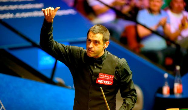 Ronnie O'Sullivan celebrates after beating Steven Maguire during day two of the 2018 Betfred World Championship at The Crucible