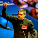 Ronnie O'Sullivan celebrates winning a 19th major title