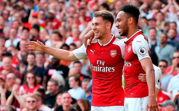 Arsenal's Aaron Ramsey (left) celebrates scoring his side's second goal of the game with team mates during the Premier League match at the Emirates Stadium