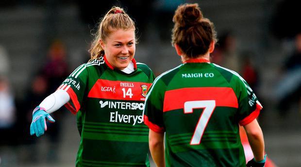 Sarah Rowe, left, and Doireann Hughes of Mayo following their victory in the Lidl Ladies Football National League Division 1 semi-final match between Cork and Mayo at St Brendan's Park in Birr, Offaly. Photo by Ramsey Cardy/Sportsfile
