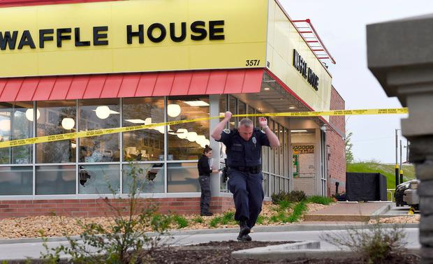 Law enforcement officials work the scene of a fatal shooting at a Waffle House in the Antioch neighborhood of Nashville. (George Walker IV/The Tennessean via AP)