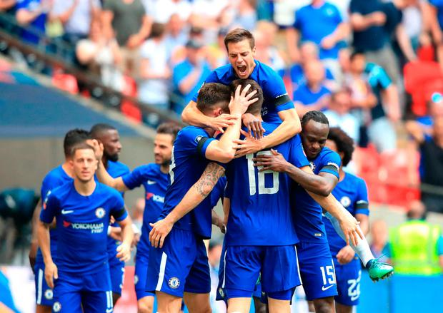 BLUE IS THE COLOUR: Chelsea players celebrate their FA Cup semi-final victory over Southampton. Photo: PA