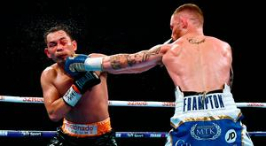 Carl Frampton lands a punch on Nonito Donaire during their WBO Interim World Featherweight bout in Belfast. Photo: Getty Images