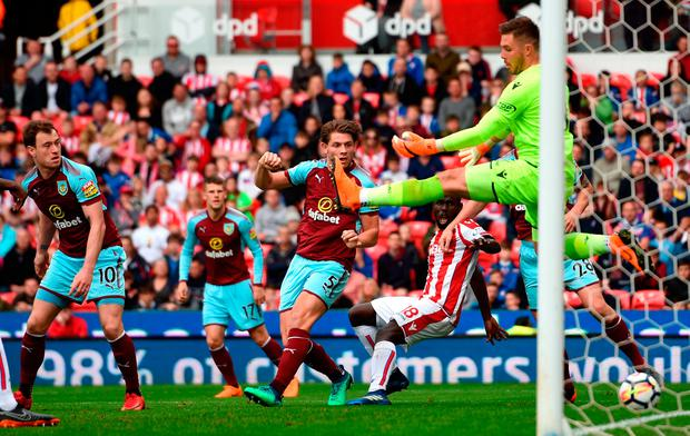 Burnley's Ashley Barnes (right) scores his side's only goal of the game. Photo: Joe Giddens/PA Wire