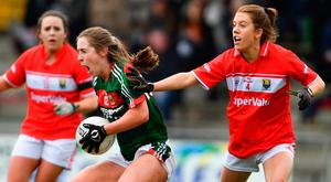 Sinead Cafferky of Mayo is tackled by Emma Spillane of Cork. Photo: Sportsfile