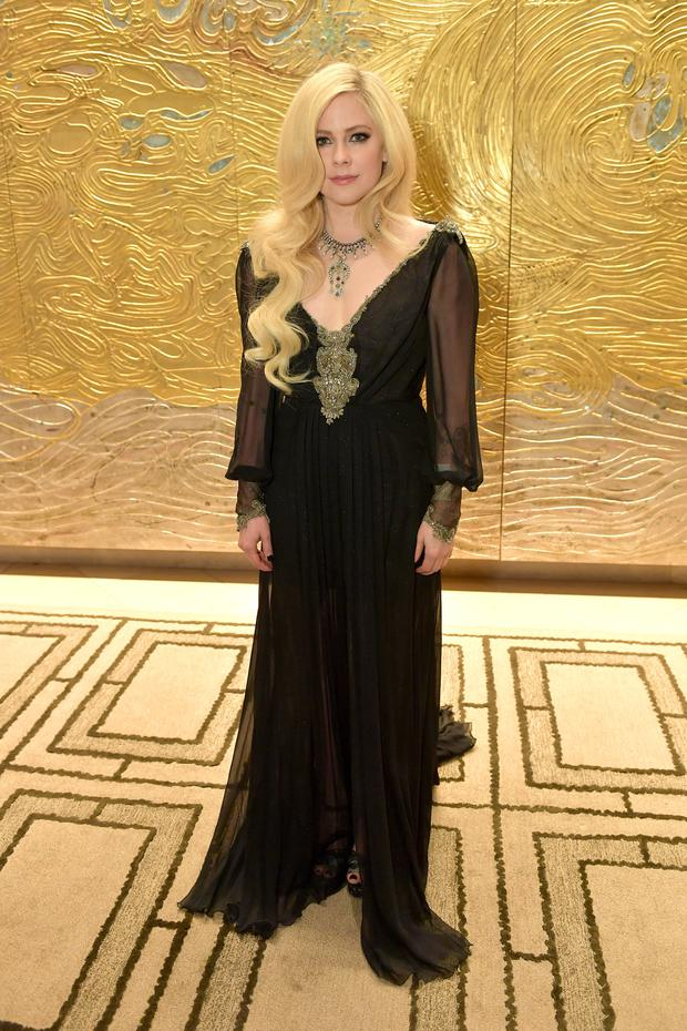 Avril Lavigne, wearing peace & love jewelry by Nancy Davis, attends the 25th Annual Race To Erase MS Gala at The Beverly Hilton Hotel on April 20, 2018 in Beverly Hills, California. (Photo by Neilson Barnard/Getty Images)