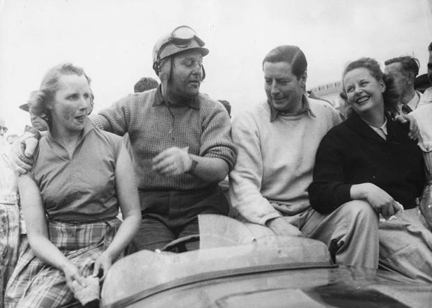 Racing drivers Tony Rolt (left) and Duncan Hamilton with their wives following their victory in the 24 hour Grand Prix d'Endurance, in their British Jaguar car, at Le Mans, June 15th 1953. (Photo by Keystone/Hulton Archive/Getty Images)
