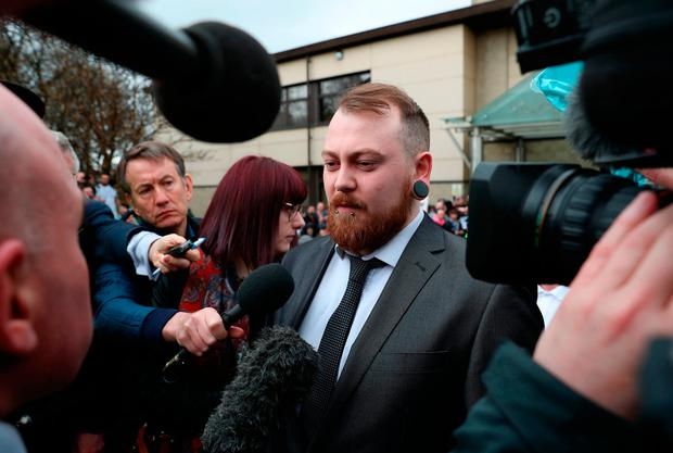 Mark Meechan speaks to the media outside Airdrie Sheriff Court where he was fined £800 for an offence under the Communications Act for posting a YouTube video of a dog giving Nazi salutes. Andrew Milligan/PA Wire
