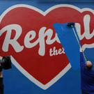 Director of the Project Arts Centre Cian O'Brien paints over a Pro-Choice 'Repeal the 8th Amendment' mural outside the Project Arts centre REUTERS/Clodagh Kilcoyne