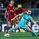 FC Barcelona's Andres Iniesta vies with AS Roma's Kevin Strootman. Photo: Filippo Monteforte/AFP/Getty