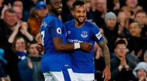 Everton's Theo Walcott celebrates scoring their first goal with Yannick Bolasie