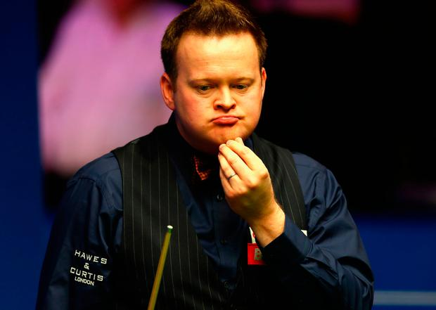 A thoughtful Shaun Murphy prepares to take a shot during his first round defeat to World No 51 Jamie Jones. Photo by Naomi Baker/Getty Images