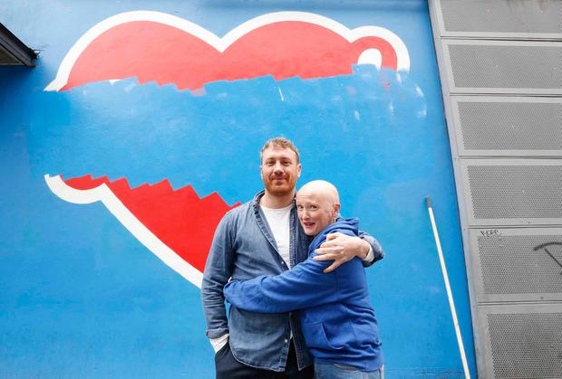 Maser, the artist of the Repeal mural, with Karen Dempsey in front of the Project Arts Centre. Photo: Sasko Lazarov