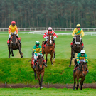 The field including eventual winner Enniskillen, second from left under Jamie Codd, negotiates the Ruby's Double obstacle during the race over the banks known as the Kildare Hunt Club Fr Sean Breen Memorial Steeplechase at Punchestown last year – the same race gets this year's Festival under way at 3.40 today with Enniskillen defending his crown. Photo by Cody Glenn/Sportsfile
