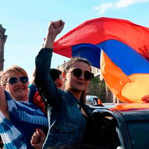 People celebrate Armenian Prime Minister Serzh Sargsyan's resignation in downtown Yerevan yesterday. Photo: Getty