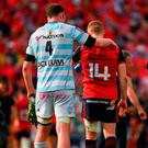 Donnacha Ryan of Racing 92 consoles his former team-mate Keith Earls of Munster
