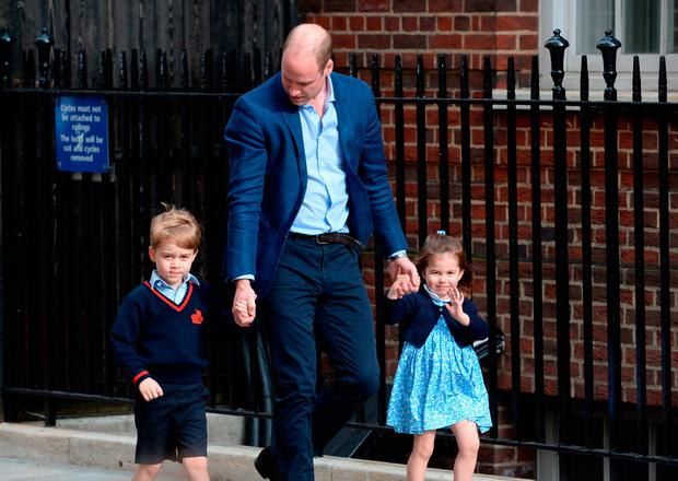 The Duke of Cambridge with Prince George and Princess Charlotte arriving at the Lindo Wing at St Mary's Hospital in Paddington, London where the Duke's third child was born on Monday