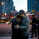 People embrace at the scene of a memorial for victims of a crash at Yonge St. at Finch Ave., after a van ploughed into pedestrians on April 23, 2018 in Toronto, Canada. A suspect identified as Alek Minassian, 25, is in custody Photo by Cole Burston/Getty Images