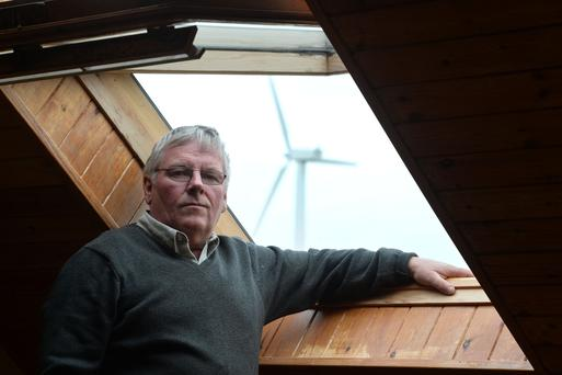 Damien Rice from Castlewellan in Co Down , who has a wind turbine at the back of his home. Photo Pacemaker Press