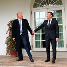 President Donald Trump and French President Emmanuel Macron walk to the Oval Office of the White House in Washington, Tuesday, April 24, 2018. Trump said the partnership he forged with Macron at the start of his presidency was a testament to the