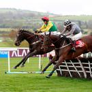 Draconien ridden by Jockey Noel Fehily (centre) on the way to winning the Herald Champion Novice Hurdle during day one of the Punchestown Festival 2018 at Punchestown
