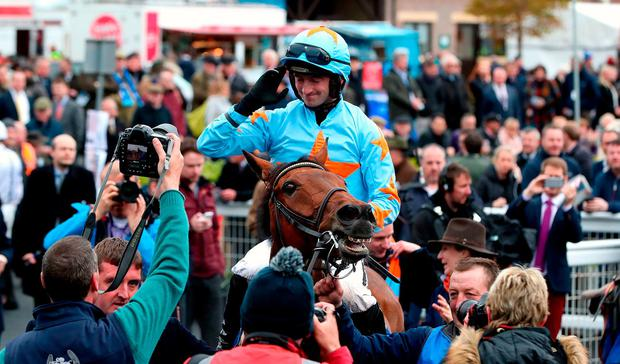 Jockey Patrick Mullins celebrates after winning the BoyleSports Champion Chase on Un De Sceaux in 2018