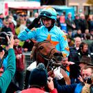 Jockey Patrick Mullins celebrates after winning the BoyleSports Champion Chase on Un De Sceaux ridden during day one of the Punchestown festival