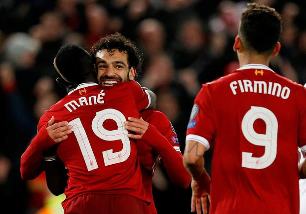 Liverpool's Sadio Mane celebrates scoring their third goal with Mohamed Salah and Roberto Firmino. REUTERS/Phil Noble
