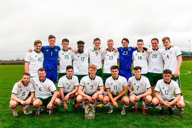 Irish College & Universities players with the trophy after the game. Photo: Harry Murphy/Sportsfile