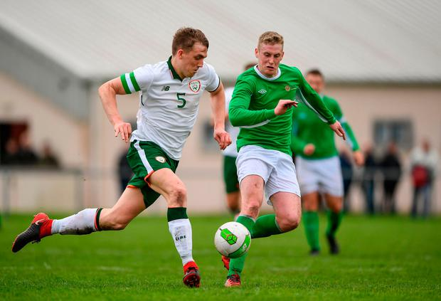 Sean O'Mahony bursts past Cian Loye of the Irish Defence Forces. Photo: Harry Murphy/Sportsfile