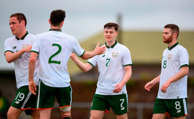 Jason McClelland of the Irish College & Universities, centre, celebrates scoring with teammates Alan O'Sullivan, Pierce Phillips and Anthony Mcalavey during the College & Universities Friendly match between Irish Defence Forces and Ireland at Collins Barracks in Cork. Photo: Harry Murphy/Sportsfile