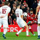 Mo Salah curls the opening goal past the Roma defence to give Liverpool the lead at Anfield last night. Photo: Reuters/Carl Recine