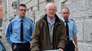 Ex-priest John Calnan (centre) absolved the six-year-old girl of her sins after abusing her. Picture: Provision