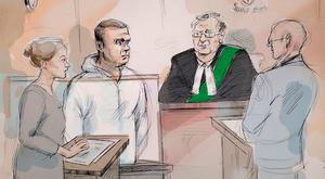A courtroom sketch depicts Alek Minassian, in white, appearing in court in Toronto yesterday. (Alexandra Newbould/The Canadian Press via AP)