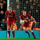 Liverpool's English midfielder James Milner concedes a penalty with a hand ball during the UEFA Champions League first leg semi-final football match between Liverpool and Roma at Anfield stadium in Liverpool, north west England on April 24, 2018. / AFP PHOTO / Oli SCARFFOLI SCARFF/AFP/Getty Images