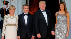 United States President Donald Trump and first lady Melania Trump welcome French President Emmanuel Macron and his wife Brigitte for a State Dinner at the White House in Washington, U.S., April 24, 2018. REUTERS/Brian Snyder