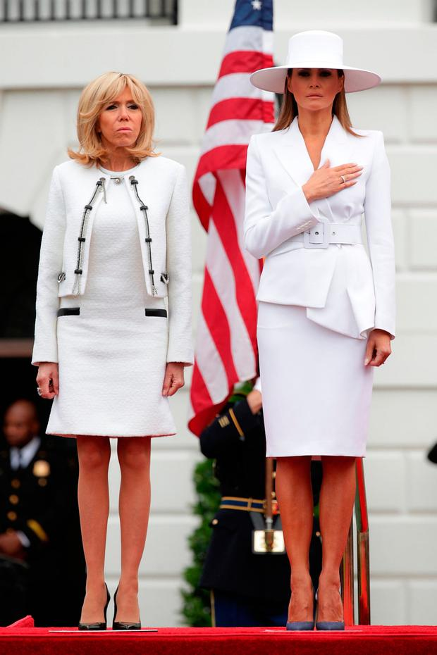 U.S. first lady Melania Trump (R) and French first lady Brigitte Macron (L) participate in a state arrival ceremony at the South Lawn of the White House April 24, 2018 in Washington, DC