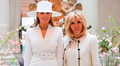 US First Lady Melania Trump and Brigitte Macron, wife of the French President, tour the National Gallery of Art in Washington, DC, April 24, 2018. / AFP PHOTO / SAUL LOEBSAUL LOEB/AFP/Getty Images