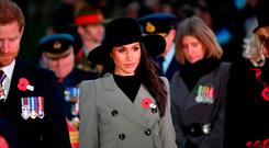Prince Harry and his fiancee Meghan Markle attend the Dawn Service at Wellington Arch to commemorate Anzac Day in London
