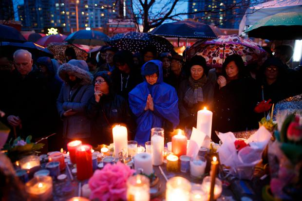 People pray for the victims of the mass killing at a vigil on April 24, 2018 in Toronto, Canada. A suspect identified by police as Alek Minassian, 25, is in custody after a driver in a white rental van yesterday sped onto a crowded sidewalk, killing 10 and injuring at least 16. (Photo by Cole Burston/Getty Images)