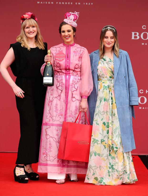 Alex Butler, centre, from Middleton, Cork, winner of the best dressed competition for day 1 with judges Rosie Fortscue, right, and Sophie White at the first day at the Punchestown Races. Picture: Damien Eagers