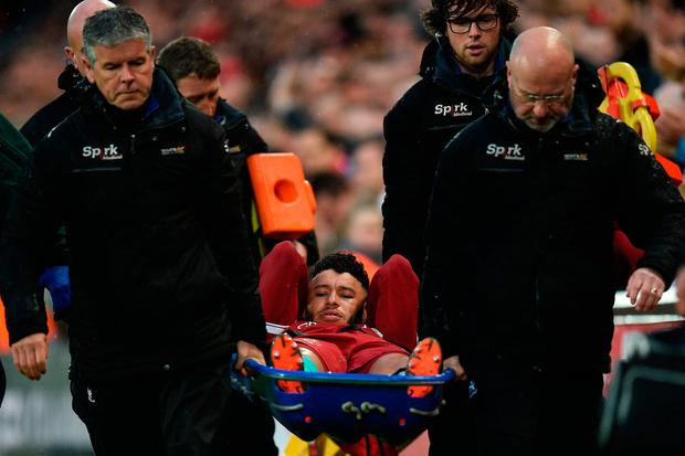 Alex Oxlade-Chamberlain: Liverpool midfielder says knee operation 'a success'
