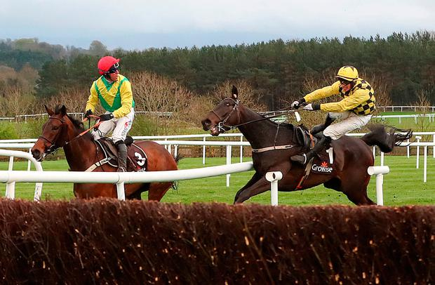 Al Bourm Photo ridden by Jockey Paul Townend (right) collides with Finian's Oscar ridden by Jockey Robbie Power (left) during day one of the Punchestown Festival 2018 at Punchestown Racecourse, County Kildare. Tuesday April 24, 2018. Niall Carson/PA Wire