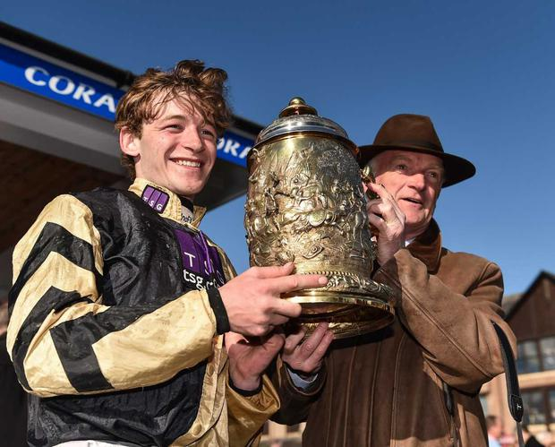Jockey David Mullins, left, and trainer Willie Mullins celebrate with the trophy after winning the Coral Punchestown Gold Cup on Bellshill at Punchestown Racecourse in Naas, Co. Kildare. Photo by Seb Daly/Sportsfile